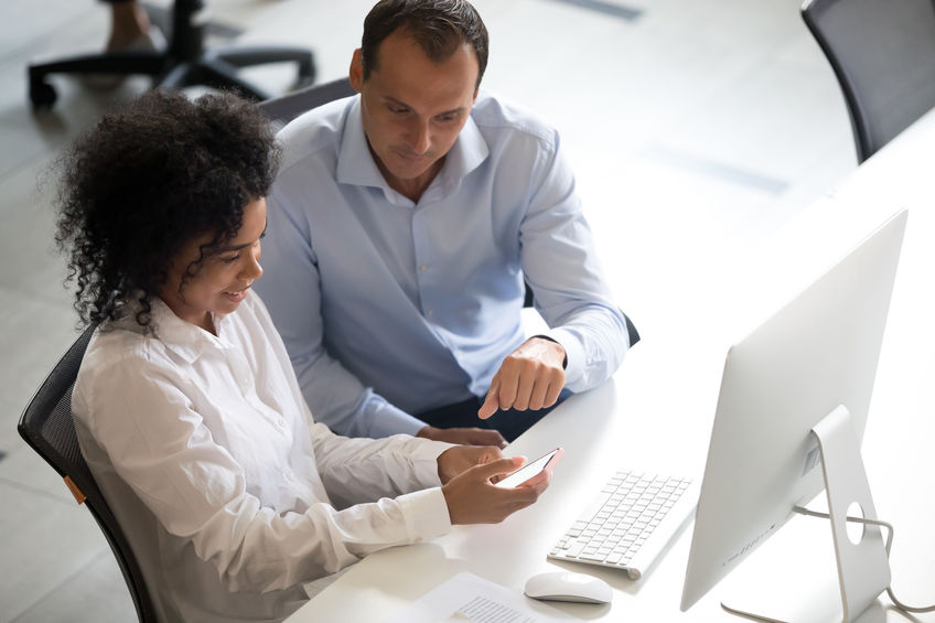 Man and woman working at computer